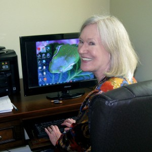 Author Claire Matturro at her computer