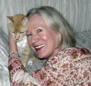 Author Claire Matturro and yellow tabby Victor